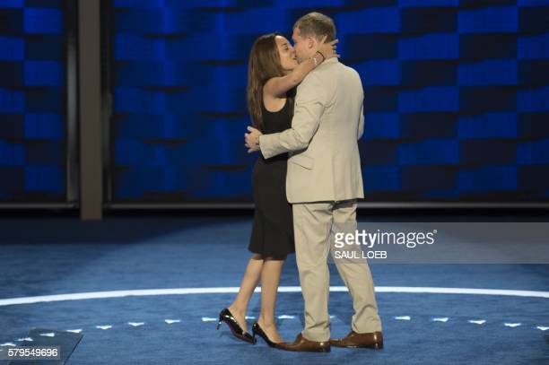 Andrew Binns kisses Liz Hart both Democratic National Convention staffers after proposing on stage at the Wells Fargo Center in Philadelphia...