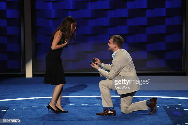 Andrew Binns proposes to Liz Hart of the Democratic National Committee at the Wells Fargo Center July 24 2016 in Philadelphia Pennsylvania An...