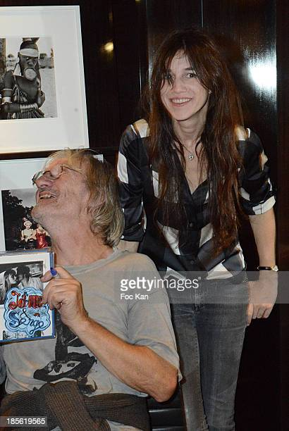 Andrew Birkin and Charlotte Gainsbourg attend the 'Jane Et Serge A Family Album' Book Signing At Taschen Odeon on October 22 2013 in Paris France