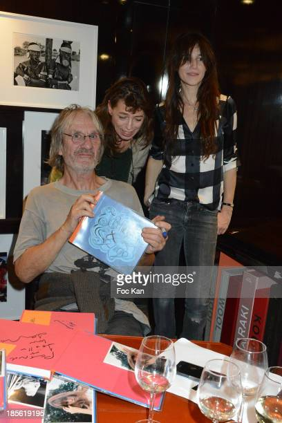 Andrew Birkin Kate Barry and Charlotte Gainsbourg attend the 'Jane Et Serge A Family Album' Book Signing At Taschen Odeon on October 22 2013 in Paris...