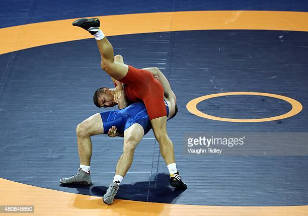Andrew Bisek of the USA and Alvis Almendra of Panama compete for the Men's 75kg GrecoRoman Gold Medal during the Toronto 2015 Pan Am Games at the...
