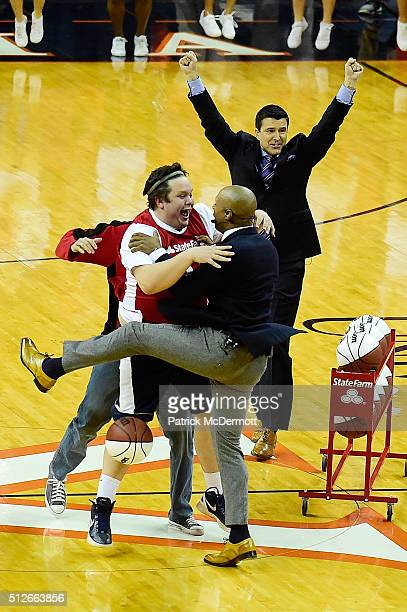 Andrew Board celebrates with ESPN College GameDay host Jay Williams after making a halfcoart shot for $18000 during a live broadcast of ESPN College...