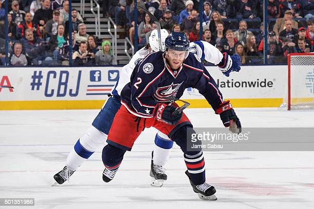 Andrew Bodnarchuk of the Columbus Blue Jackets and Brian Boyle of the Tampa Bay Lightning skate after a loose puck during the second period of a game...
