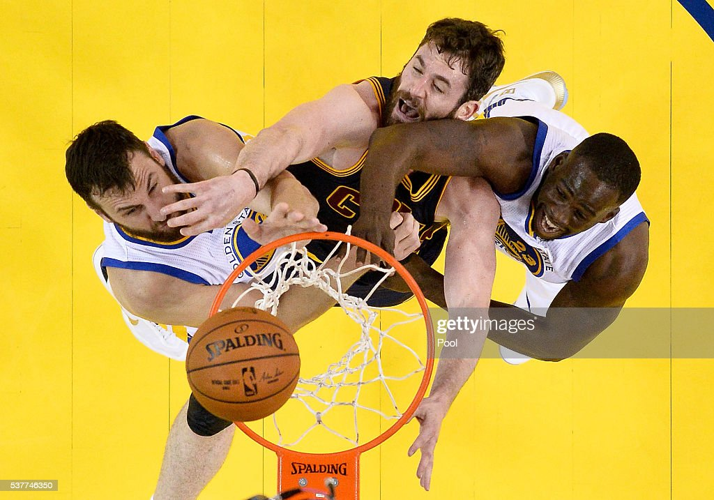 Andrew Bogut #12 and Draymond Green #23 of the Golden State Warriors battle for a rebound against Kevin Love #0 of the Cleveland Cavaliers in Game 1 of the 2016 NBA Finals at ORACLE Arena on June 2, 2016 in Oakland, California.