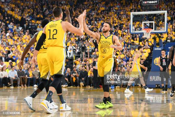 Andrew Bogut and Stephen Curry of the Golden State Warriors high five in Game Two of Round One against the LA Clippers during the 2019 NBA Playoffs...