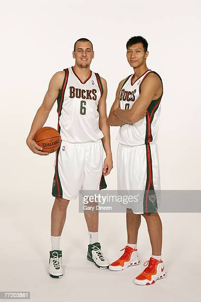 Andrew Bogut and Yi Jianlian of the Milwaukee Bucks pose for a portrait during NBA Media Day at the Bucks Training Center on October 5 2007 in St...