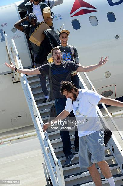 Andrew Bogut David Lee and Stephen Curry of the Golden State Warriors greets the fans of the Golden State Warriors as the team arrives home from...