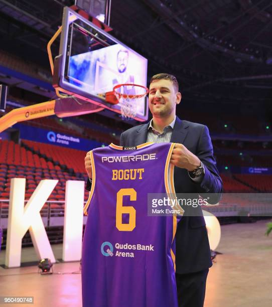Andrew Bogut holds up a Kings singlet as he is unveiled as a Sydney Kings player at Qudos Bank Arena on April 24 2018 in Sydney Australia
