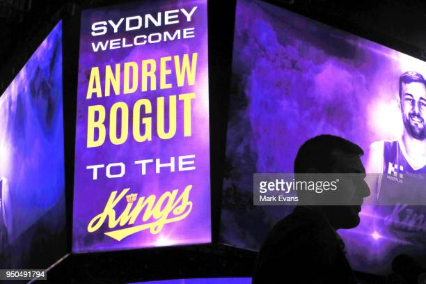 Andrew Bogut is silhouetted against a big screen during a media conference as he is unveiled as a Sydney Kings player at Qudos Bank Arena on April 24...