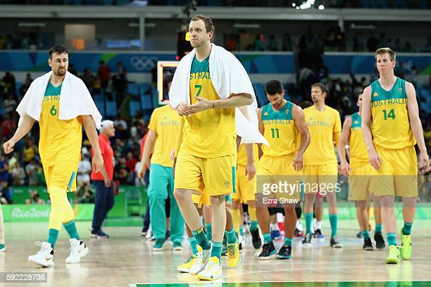 Andrew Bogut Joe Ingles and Brock Motum of Australia walk off the court with teammates after being defeated by Serbia in the Men's Semifinal match on...