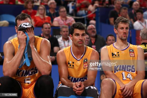 Andrew Bogut, Kevin Lisch and Daniel Kickert of the Kings sit on the bench during the round 10 NBL match between the Perth Wildcats and the Sydney...