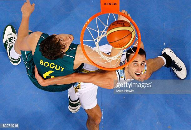 Andrew Bogut of Australia and Manu Ginobili of Argentina look up at the ball on the rim in the preliminary basketball game held at the Beijing...