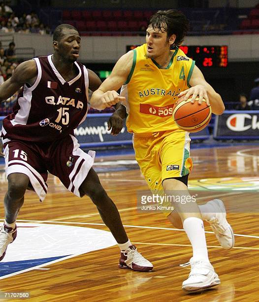 Andrew Bogut of Australia drives to the basket against Qatar during the preliminary round of the 2006 FIBA World Championships on August 24 2006 in...