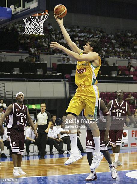 Andrew Bogut of Australia shoots against Qatar during the preliminary round of FIBA World Championships 2006 on August 24 2006 in Hamamatsu Japan The...