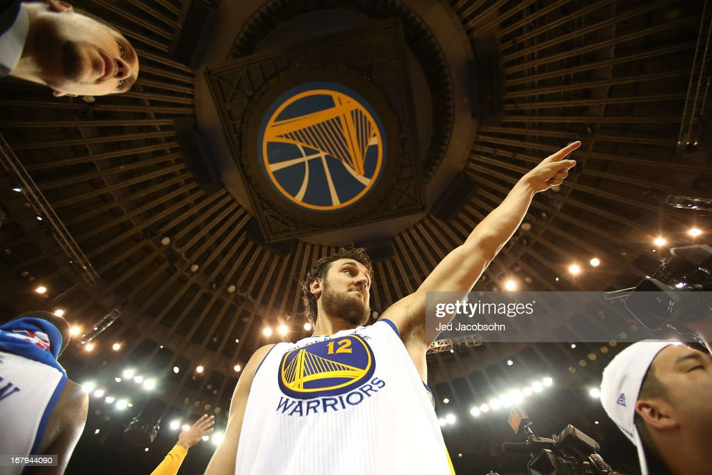 Andrew Bogut #12 of the Golden State Warriors celebrates after defeating the Denver Nuggets during Game Six of the Western Conference Quarterfinals of the 2013 NBA Playoffs at ORACLE Arena on May 2, 2013 in Oakland, California.