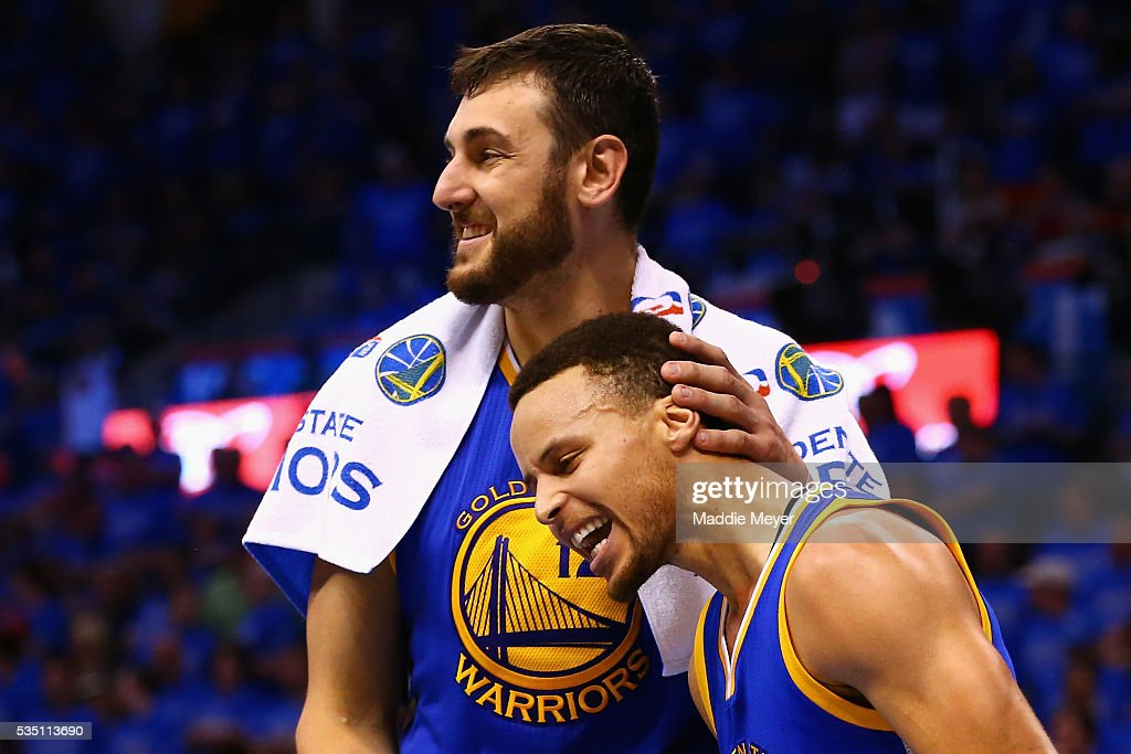 Andrew Bogut #12 of the Golden State Warriors celebrates with Stephen Curry #30 during the fourth quarter against the Oklahoma City Thunder in game six of the Western Conference Finals during the 2016 NBA Playoffs at Chesapeake Energy Arena on May 28, 2016 in Oklahoma City, Oklahoma.