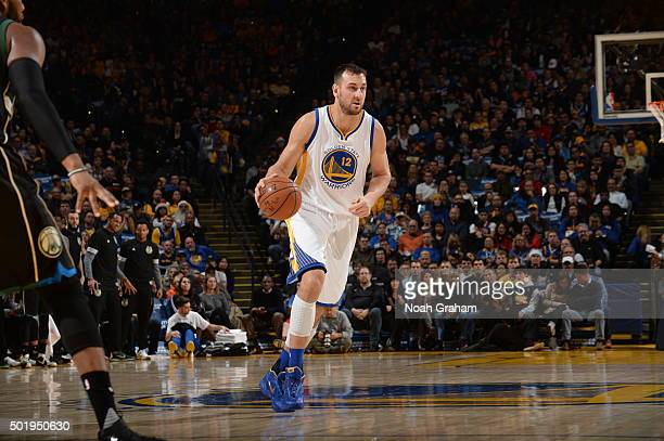 Andrew Bogut of the Golden State Warriors dribbles the ball against the Milwaukee Bucks on December 18 2015 at Oracle Arena in Oakland California...