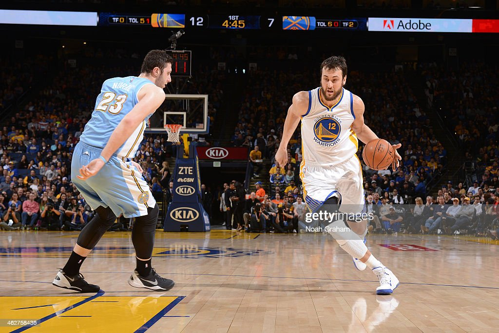Andrew Bogut #12 of the Golden State Warriors drives against Jusuf Nurkic #23 of the Denver Nuggets on January 19, 2015 at Oracle Arena in Oakland, California.