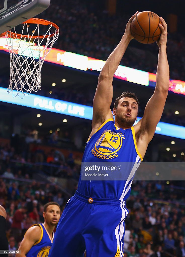 Andrew Bogut #12 of the Golden State Warriors grabs a rebound during the third quarter against the Boston Celtics at TD Garden on December 11, 2015 in Boston, Massachusetts.The Warriors defeat the Celtics 124-119.