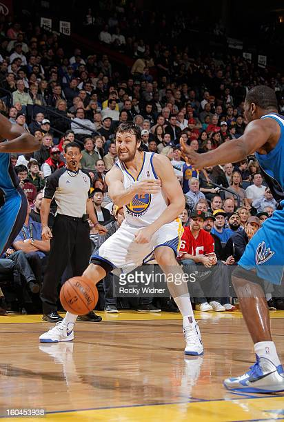 Andrew Bogut of the Golden State Warriors passes against the Dallas Mavericks on January 31, 2013 at Oracle Arena in Oakland, California. NOTE TO...