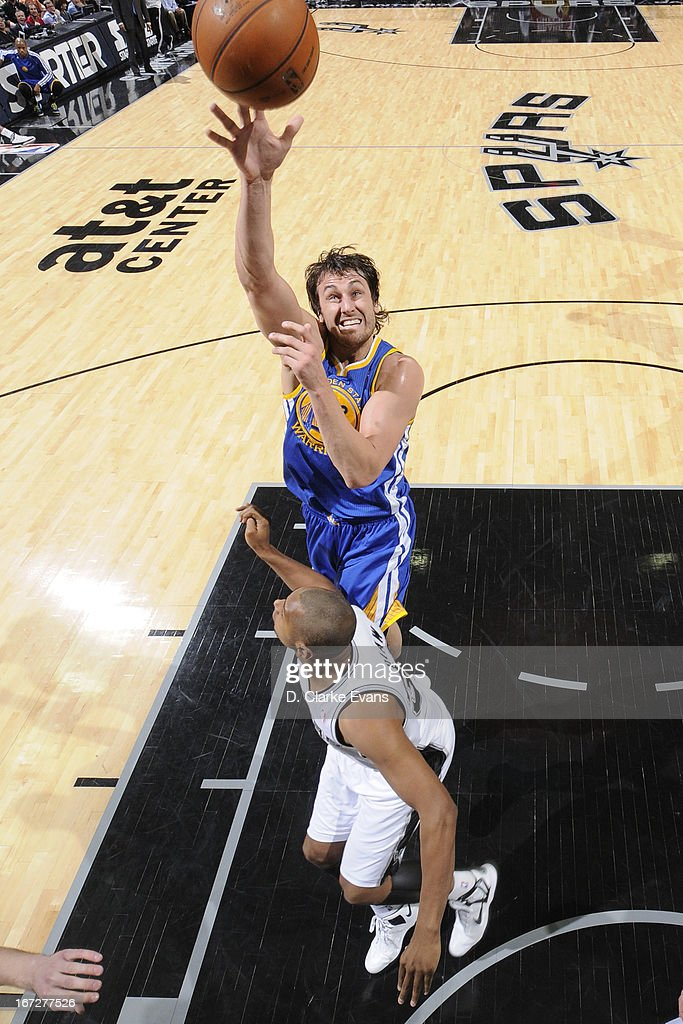 Andrew Bogut #12 of the Golden State Warriors puts up a shot against the San Antonio Spurs on March 20, 2013 at the AT&T Center in San Antonio, Texas.
