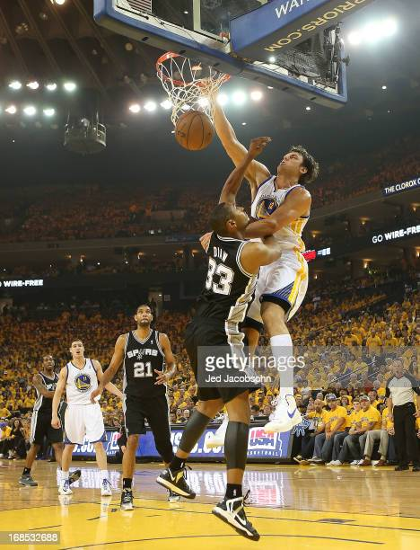 Andrew Bogut of the Golden State Warriors shoots against Tim Duncan of the San Antonio Spurs in Game Three of the Western Conference Semifinals...