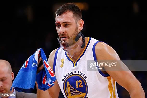 Andrew Bogut of the Golden State Warriors walks off the court after being cut during the NBA season opener against the New Orleans Pelicans at ORACLE...