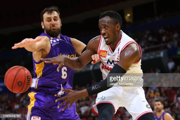 Andrew Bogut of the Kings and Cedric Jackson of the Hawks compete for the ball during the round 13 NBL match between the Sydney Kings and the...