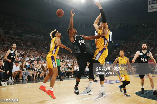 Andrew Bogut of the Kings blocks Casper Ware of United during game one of the NBL Semi Final series between Melbourne United and the Sydney Kings at...