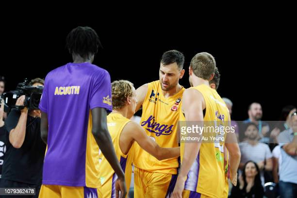 Andrew Bogut of the Kings celebrates with the team after winning the round eight NBL match between the New Zealand Breakers and the Sydney Kings at...