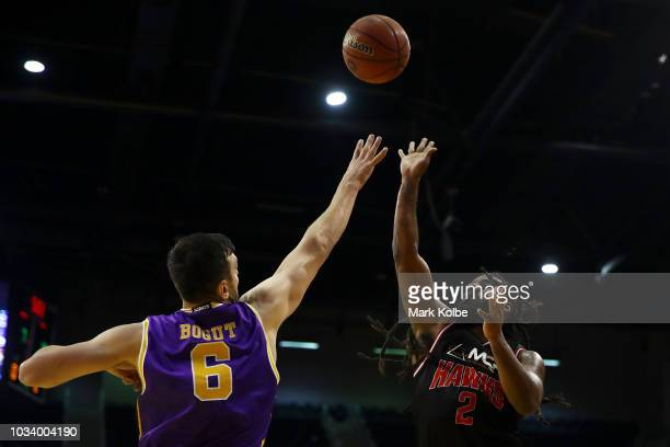 Andrew Bogut of the Kings defends the shot from Jordair Jett of the Hawks during the NBL preseason match between the Illawarra Hawks and the Sydney...