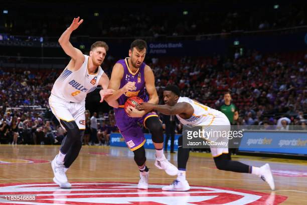 Andrew Bogut of the Kings drives to the basket during the round four NBL match between the Sydney Kings and the Brisbane Bullets at Qudos Bank Arena...