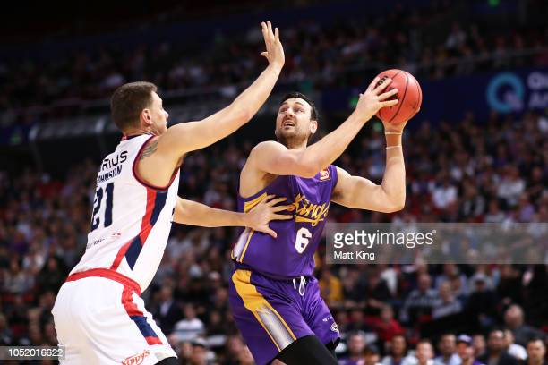 Andrew Bogut of the Kings drives to the basket during the round one NBL match between the Sydney Kings and the Adelaide 36ers at Qudos Bank Arena on...