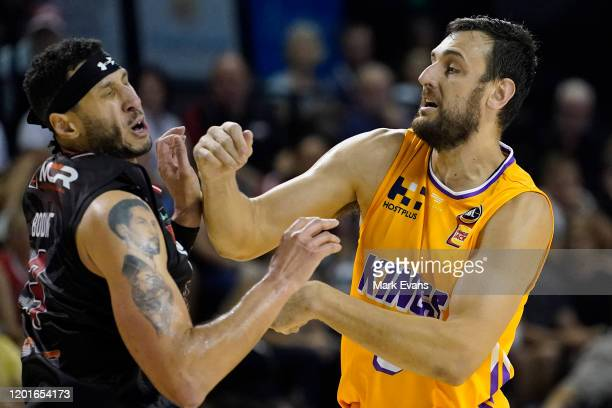 Andrew Bogut of the Kings hits Josh Boone of the Hawks in the face during the round 17 NBL match between the Illawarra Hawks and the Sydney Kings at...
