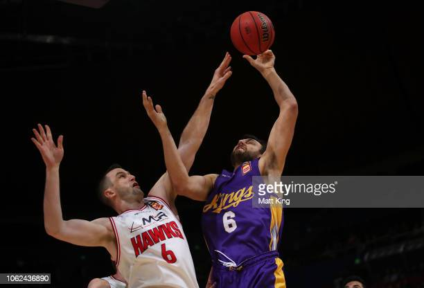 Andrew Bogut of the Kings rebounds under pressure from AJ Ogilvy of the Hawks during the round four NBL match between the Sydney Kings and the...