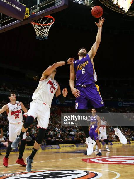 Andrew Bogut of the Kings rebounds under pressure from David Andersen of the Hawks during the round four NBL match between the Sydney Kings and the...