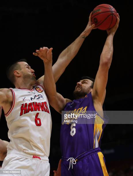 Andrew Bogut of the Kings shoots under pressure from AJ Ogilvy of the Hawks during the round four NBL match between the Sydney Kings and the...