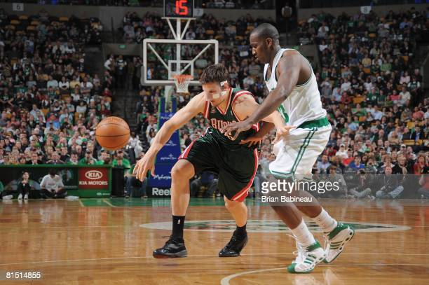 Andrew Bogut of the Milwaukee Bucks attempts to move the ball against Kendrick Perkins of the Boston Celtics during the game on April 11 2008 at the...