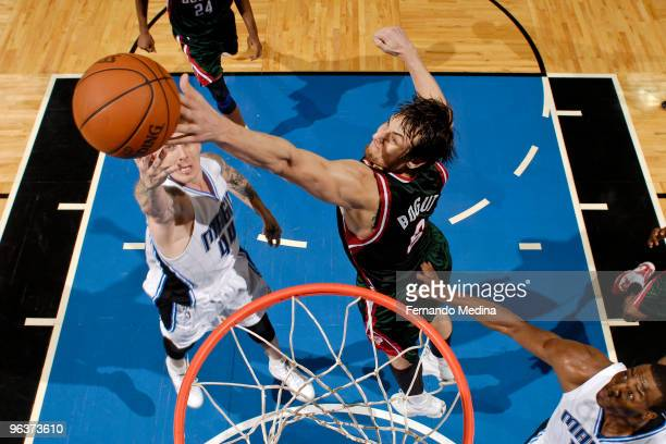 Andrew Bogut of the Milwaukee Bucks blocks a shot against Jason Williams of the Orlando Magic during the game on February 2 2010 at Amway Arena in...