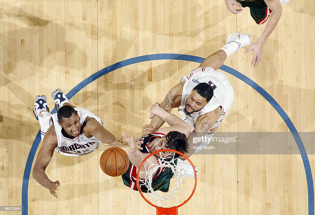 Andrew Bogut #6 of the Milwaukee Bucks blocks against Boris Diaw #32 of the Charlotte Bobcats on April 2, 2010 at the Time Warner Cable Arena in Charlotte, North Carolina.