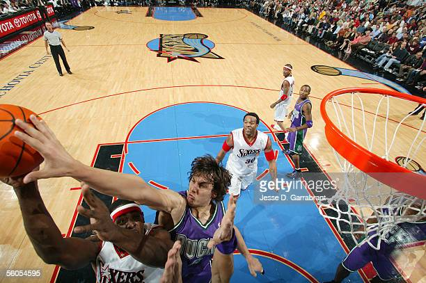 Andrew Bogut of the Milwaukee Bucks blocks Chris Webber on the Philadelphia 76ers on November 1 2005 at the Wachovia Center in Philadelphia...