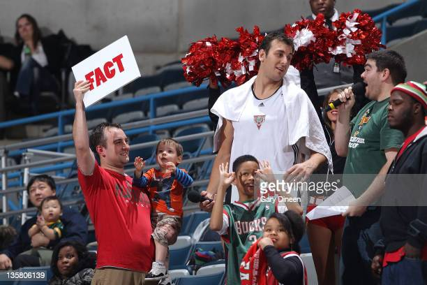 Andrew Bogut of the Milwaukee Bucks competes against a fan in a trivia contest during the Milwaukee Bucks open practice on December 14 2011 at the...