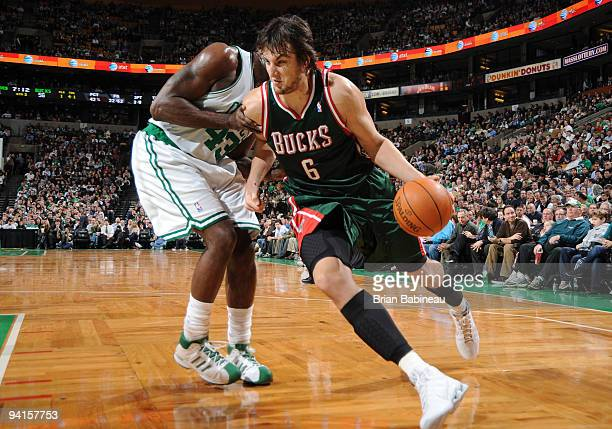 Andrew Bogut of the Milwaukee Bucks drives to the basket against Kendrick Perkins of the Boston Celtics on December 8 2009 at the TD Garden in Boston...