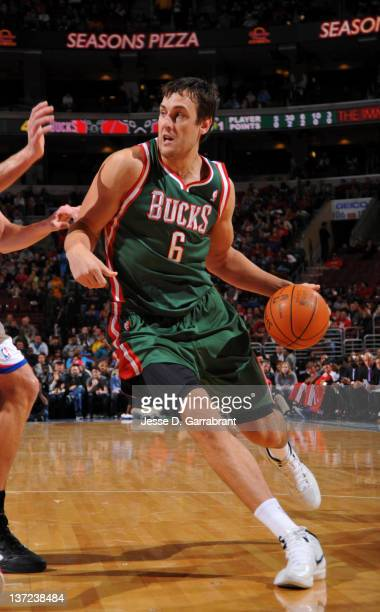 Andrew Bogut of the Milwaukee Bucks drives to the basket during the game against the Philadelphia 76ers on January 16 2012 at Wells Fargo Center in...