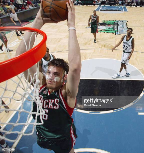 Andrew Bogut of the Milwaukee Bucks dunks against the Minnesota Timberwolves on April 16 2008 at the Target Center in Minneapolis Minnesota NOTE TO...