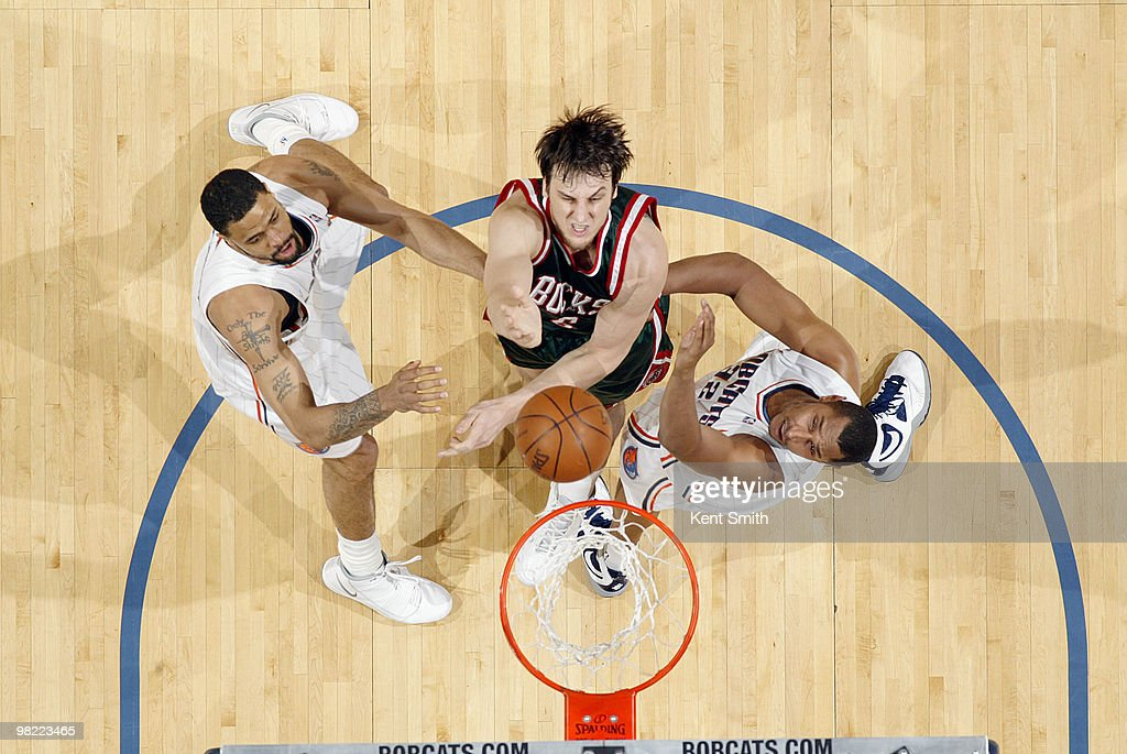 Andrew Bogut #6 of the Milwaukee Bucks goes for the layup against Boris Diaw #32 of the Charlotte Bobcats on April 2, 2010 at the Time Warner Cable Arena in Charlotte, North Carolina.