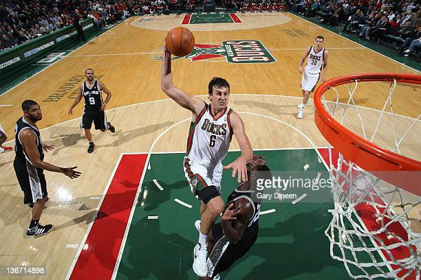 Andrew Bogut of the Milwaukee Bucks goes to the basket against DeJuan Blair of the San Antonio Spurs during the game on January 10 2012 at the...