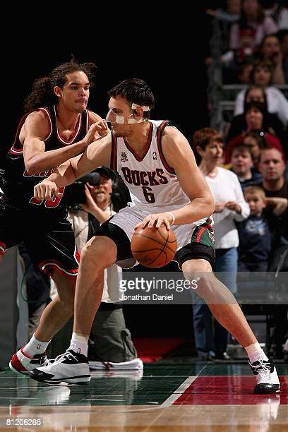 Andrew Bogut of the Milwaukee Bucks goes up against Joakim Noah of the Chicago Bulls during the game on April 14 2008 at the Bradley Center in...