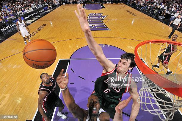 Andrew Bogut of the Milwaukee Bucks goes up to block a shot by Carl Landry of the Sacramento Kings during the game at Arco Arena on March 19 2010 in...