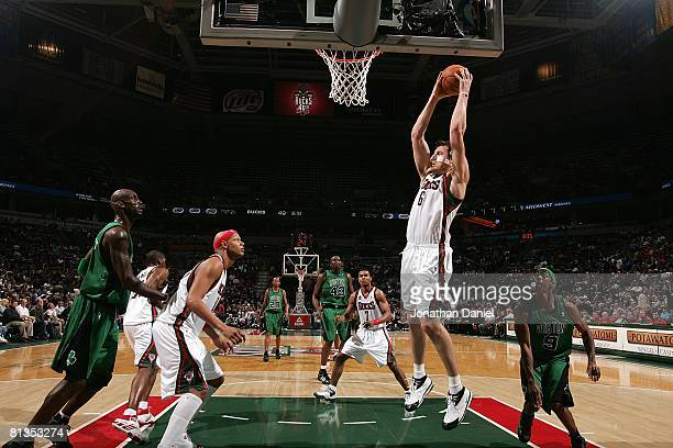 Andrew Bogut of the Milwaukee Bucks grabs a rebound against the Boston Celtics during the game on April 8 2008 at the Bradley Center in Milwaukee...